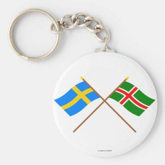 Banderas del landskap cruzado de Suecia y de Småla Llaveros
