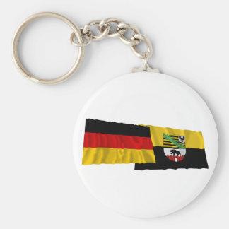 Banderas que agitan de Alemania y de Llavero Redondo Tipo Pin