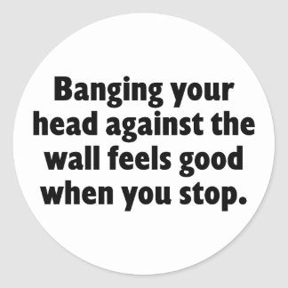 Banging your head against a brick wall classic round sticker