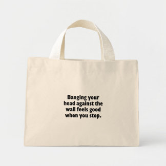 Banging your head against a brick wall mini tote bag
