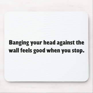 Banging your head against a brick wall mousepad