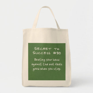 Banging your head against the wall tote bag
