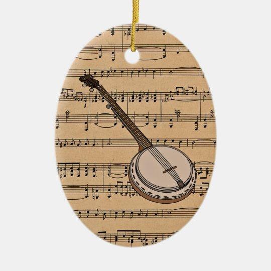 Banjo con el fondo de la partitura adorno navideño ovalado de cerámica