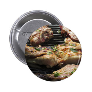 Barbecued steak and chicken on the grill 2 inch round button