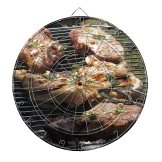 Barbecued steak and chicken on the grill dart boards