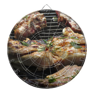 Barbecued steak and chicken on the grill dartboard
