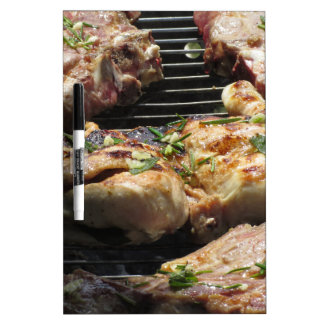 Barbecued steak and chicken on the grill dry erase board