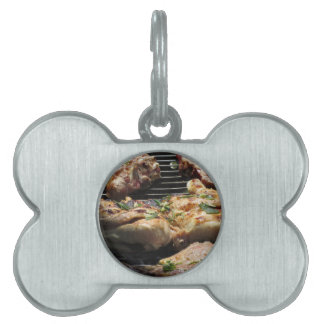 Barbecued steak and chicken on the grill pet ID tag