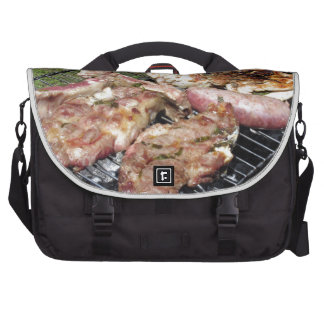 Barbecued steak and sausages on the grill commuter bag