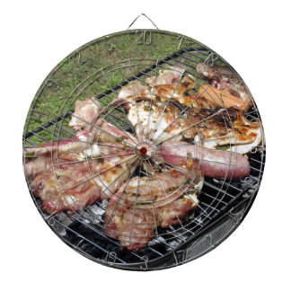 Barbecued steak and sausages on the grill dart boards