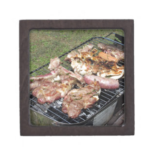 Barbecued steak and sausages on the grill gift box