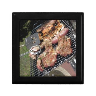 Barbecued steak and sausages on the grill jewelry box