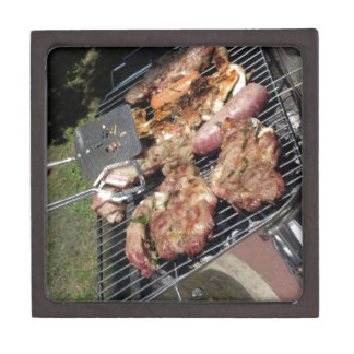 Barbecued steak and sausages on the grill keepsake box