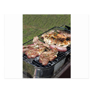 Barbecued steak and sausages on the grill postcard