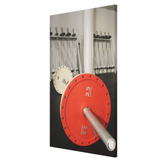Barbell in gym stretched canvas prints