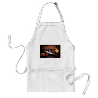 Barbequed beef ribs and corn. adult apron