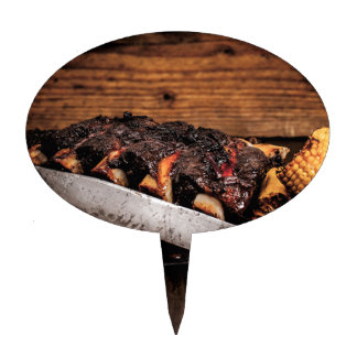 Barbequed beef ribs and corn. cake picks