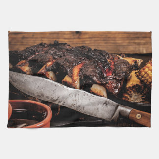 Barbequed beef ribs and corn. kitchen towel