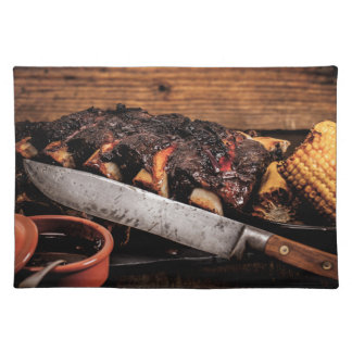 Barbequed beef ribs and corn. place mats