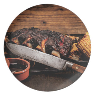 Barbequed beef ribs and corn. party plate