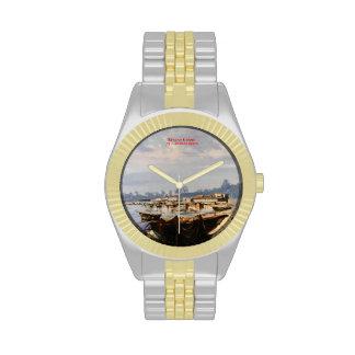 Barca en la playa reloj de mano