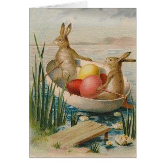 Barco coloreado del huevo del conejo de conejito d tarjeta de felicitación