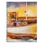 Barco de pesca náutico en la playa en el arte del  libreta espiral