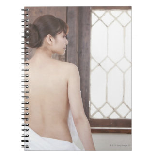 Bare Back of Young Woman Notebook