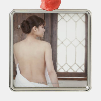Bare Back of Young Woman Christmas Ornaments