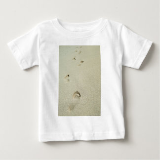 Barefoot footprints on sand baby T-Shirt
