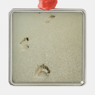 Barefoot footprints on sand metal ornament