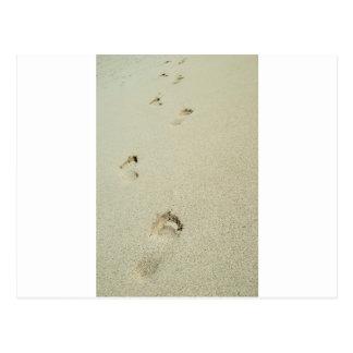 Barefoot footprints on sand postcard