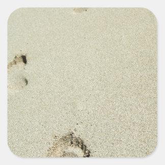 Barefoot footprints on sand square sticker
