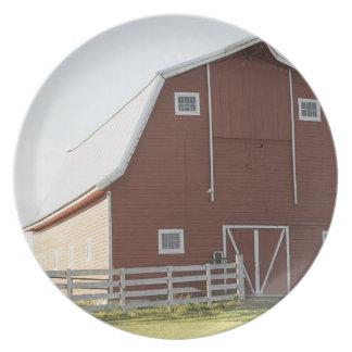Barn in rural landscape dinner plate