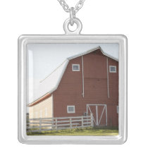 Barn in rural landscape silver plated necklace