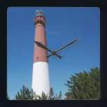"Barnegat Lighthouse Old Barney Square Wall Clock<br><div class=""desc"">This is a photo of Barnegat Lighthouse, affectionately known as &quot;Old Barney&quot; and was taken on a beautiful warm sunny day from the nearby maritime forest at Barnegat Lighthouse State Park at the Jersey Shore. Pine trees can be seen in the foreground. It is located on the north end of...</div>"