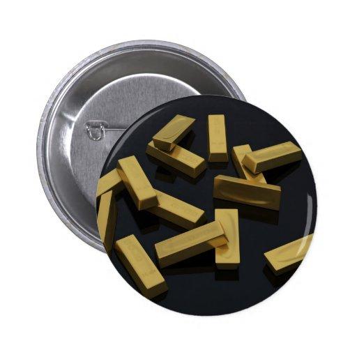 Barras de oro en bulto en un fondo negro pins