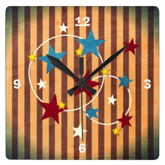 Barras y estrellas brillantes del circo del vintag reloj de pared