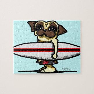 Barro amasado de la persona que practica surf puzzle con fotos