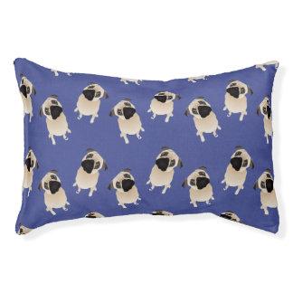 Barros amasados dulces en azul cama para mascotas