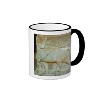 Bas-relief of an anthropomorphic bull coffee mugs