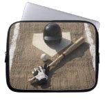 Baseball, bat, batting gloves and baseball computer sleeves
