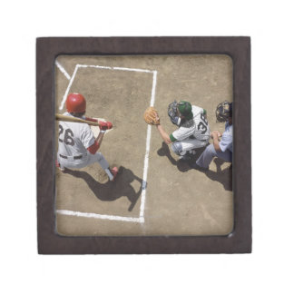Baseball batter awaiting pitch with catcher and premium trinket box