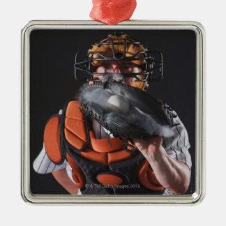 Baseball catcher holding ball in mitt metal ornament