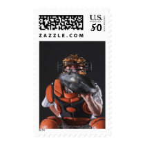 Baseball catcher holding ball in mitt postage
