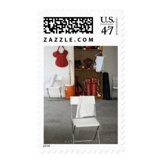 Baseball equipment in locker room postage stamp