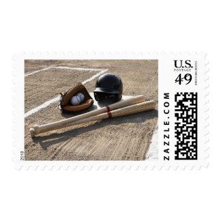 Baseball glove, balls, bats and baseball helmet postage