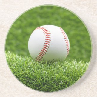 Baseball is on green grass background  coaster