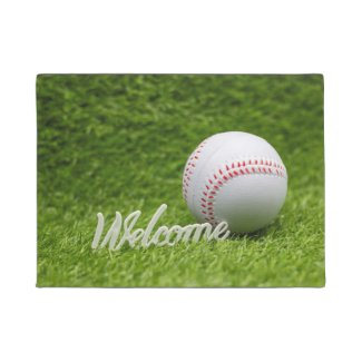 Baseball is on green grass welcome sign doormat