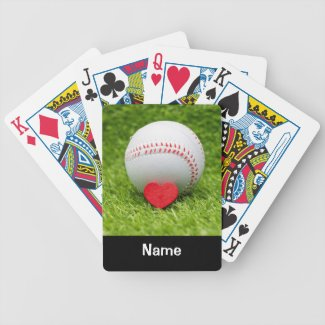 Baseball is on green grass with love wedding bicycle playing cards